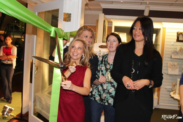 The Dandelion Patch CEO Heidi Kallett cuts the green ribbon at Thursday night's Georgetown grand opening celebration.
