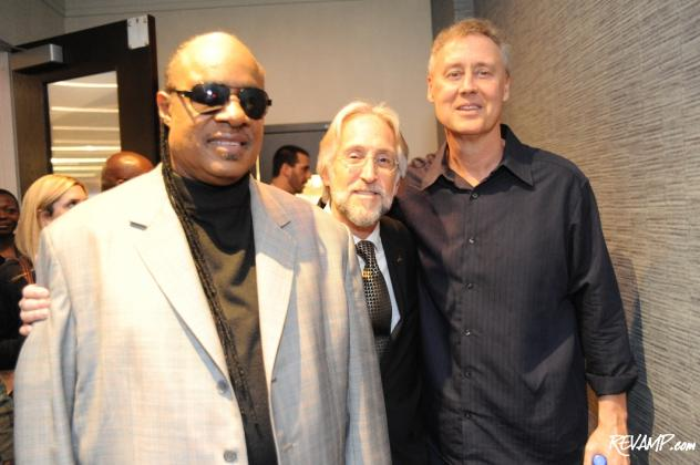 25-time GRAMMY winner Stevie Wonder, The Recording Academy President/CEO Neil Portnow, and three-time GRAMMY winner Bruce Hornsby mingling at the end of the awards ceremony.