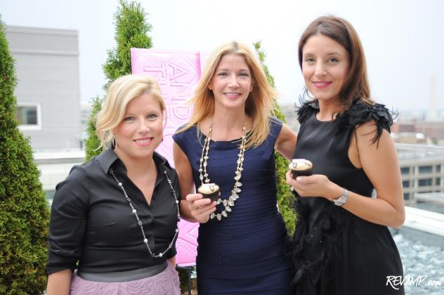 Georgetown Cupcake's Sophie LaMontagne and Katherine Kallinis flank best-selling author Candace Bushnell.