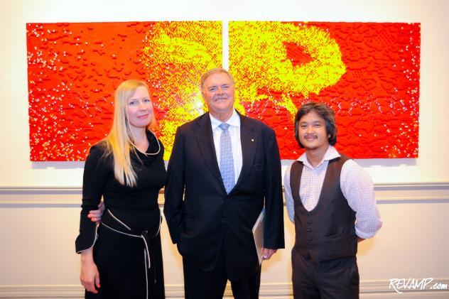 Artists Claire Healy and Sean Cordeiro flank Australian Ambassador Kim Beazley.