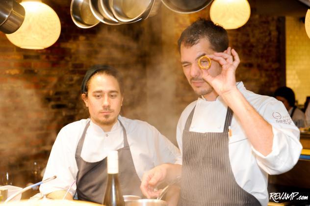 (R-L) Chef Rubén García prepares a special 'Ferrero Rocher' bite with Chef Diego Caro.