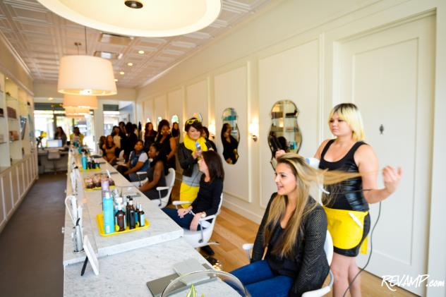 Volunteer 'hair models' receive complimentary blowouts from Drybar's Georgetown staff prior to the boutique's opening today.