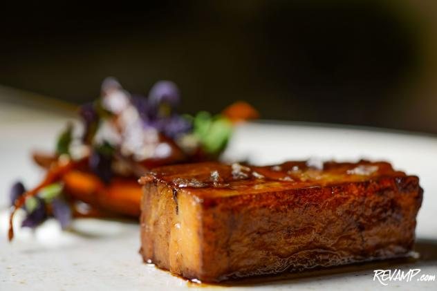 Pork Belly with baby maroon carrots, plums, cardamom-scented crème fraiche, vanilla, and sesame seeds.