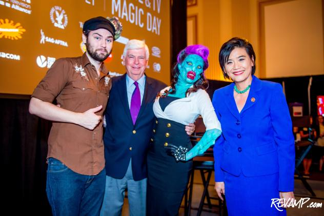 MPAA CEO/Chairman Chris Dodd and Congresswoman Judy Chu pose with a Syfy makeup artist and his 'Fish Lady' creation.