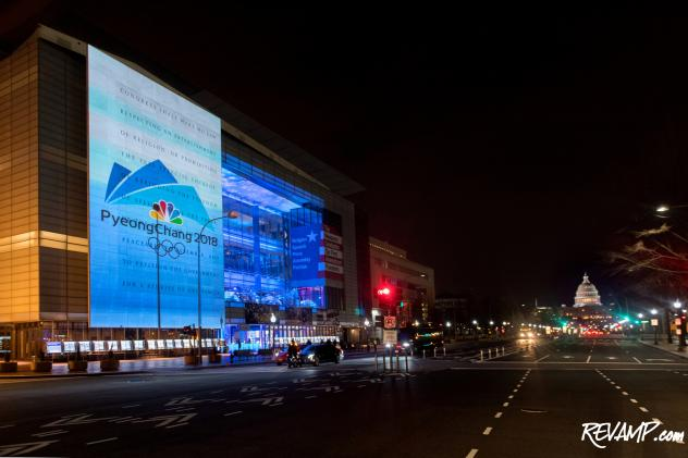 The logo of the PyeongChang Olympics was projected on the outside of the Newseum for the celebration.
