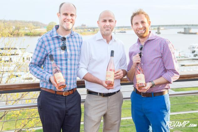 District Winery co-founders John Stires (left) and Brian Leventhal (right) flank company winemaker Conor McCormack.